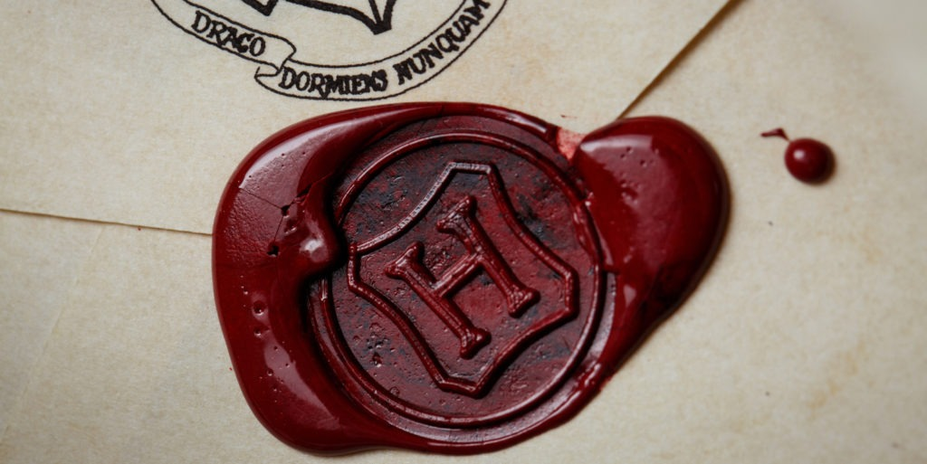 H stamped on Hogwarts Letter extreme close up